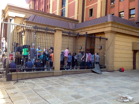 18_Media gauntlet waiting for Pistorius.JPG