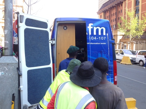 4_Local workers in Pretoria watching Oscar's fate unfold from the news van opposite the court house.JPG