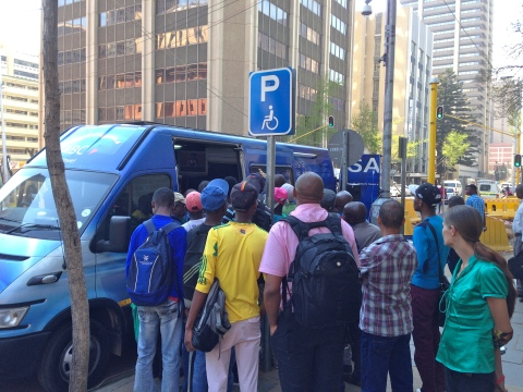 8_Attention grabbing_SABC news-van broadcasting the verdict live from opposite the court house. As the day went by, more and more people stopped to watch and listen in.JPG