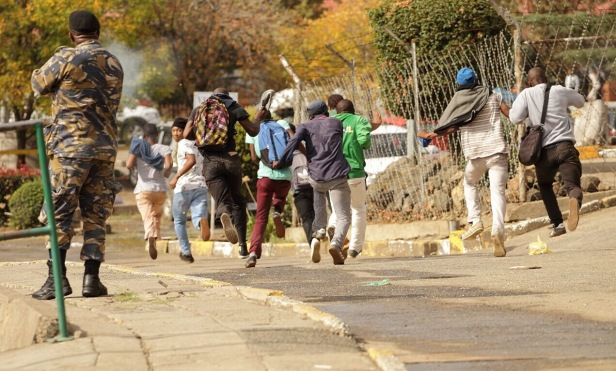 Students running from police during protests at National University of Lesotho_photo by Justice Kalebe
