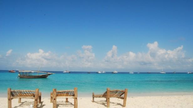 Intrepid-Travel-tanzania_zanzibar-island_beach-chairs-blue-water-sky_jess wight
